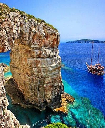 "The natural arch rock ""Tripitos"".. Paxos Island ( Ionian), Greece // by Hercules Milas"