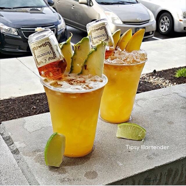 HENNY-RITAS  Mango Hennessy Cointreau Mango Puree  Sour Mix Splash of Lime Juice  Pineapple  Hennessy  Cointreau Pineapple Juice Sour Mix Splash of Lime Juice