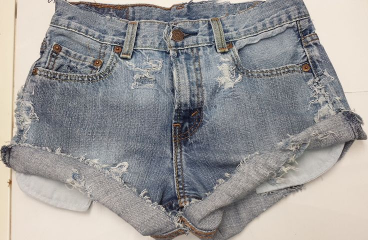 Unique Distressed High-Waisted Denim Shorts, Customized by Damsel In Distress  Distressed, Light Wash, Peek-a-Boo Pockets! Roll Shorts Up, or leave them down!  Size: waist- 27, hip 32-33