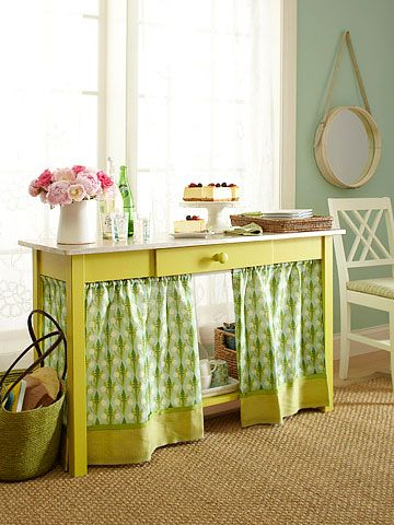 Curtains on tension rods below the table to hide cords and storage.