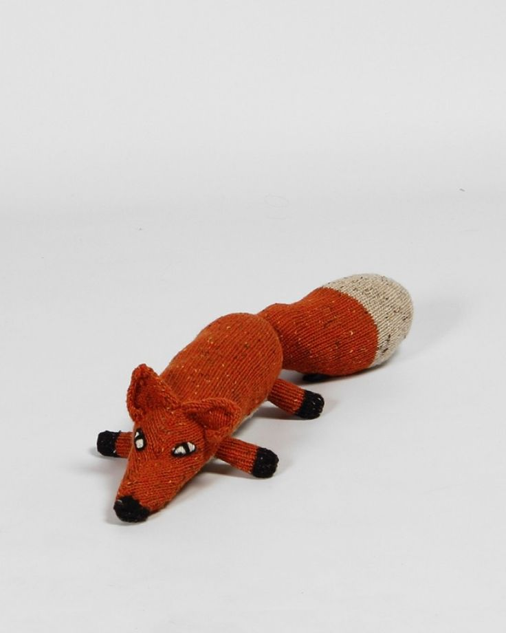 Knitted Toy | Soft Teddy | Irish Craft | Fox | Toys for Kids | Design and Craft | Gifts | Makers&Brothers |   Fionn the Fox is a hand knitted friendly Irish animal. He grew up wandering the wild and windswept mountains of Connemara. Cloaked in cloud and drenched in rain, Fionn spent his youth in the mountains, dashing through the gorse and hunting rabbits. His two best friends are Brigid the Sheep and Liam the Hare. He is faster than he looks and is very proud of his wonderful tail.