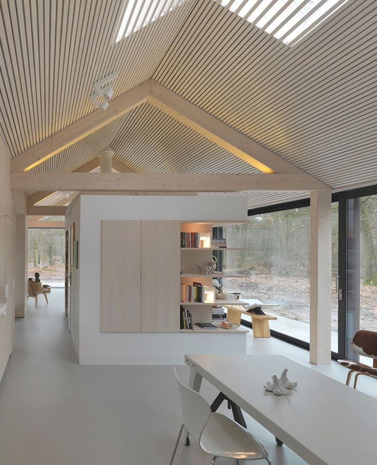 OisterwijkThe Netherlands, 2010 Interior design Modest in its appearance towards the outside, this lengthy residence has a beautiful outlook on the woodlands of the natural reserve that it stands within. The shape of the house is deceptively simple, as it mimics the archetypal form of an oblong barn, measuring 26 by 6 meters. In close…