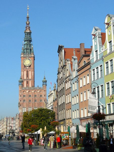The clock tower of Town Hall rises above Old Town Gdansk, Poland. Read our article for tips on exploring Gdansk on a self-guided walking tour. It's a great addition to your travel itinerary on a trip to Poland.