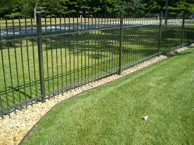 Under Fence Stone In 2019 Landscaping Along Fence