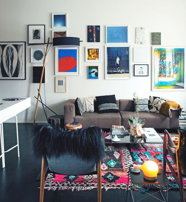 Glenn Ligon's living room blends a colorful gallery wall with a Moroccan Boucherouite rug and modern furnishings
