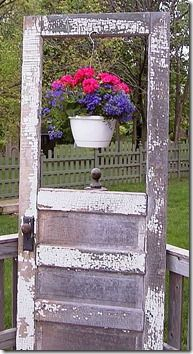 An old shabby door can be repurposed to add charm to a deck.