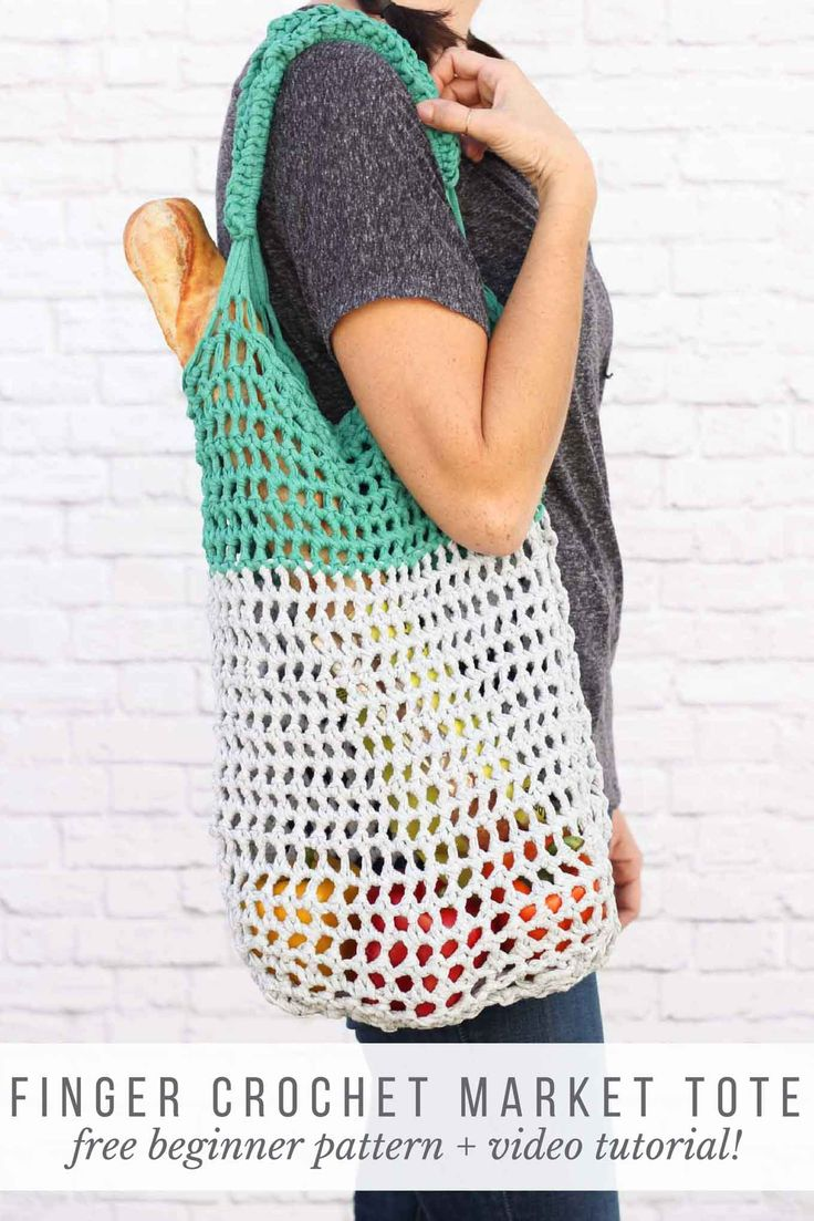 """This free market tote bag pattern and video tutorial is the perfect introduction on how to finger crochet! A speedy, satisfying project for adults and kids alike. Made using Lion Brand's Fast-Track yarn in """"Chopper Grey"""" and """"Go Kart Green.""""   MakeAndDoCrew.com"""