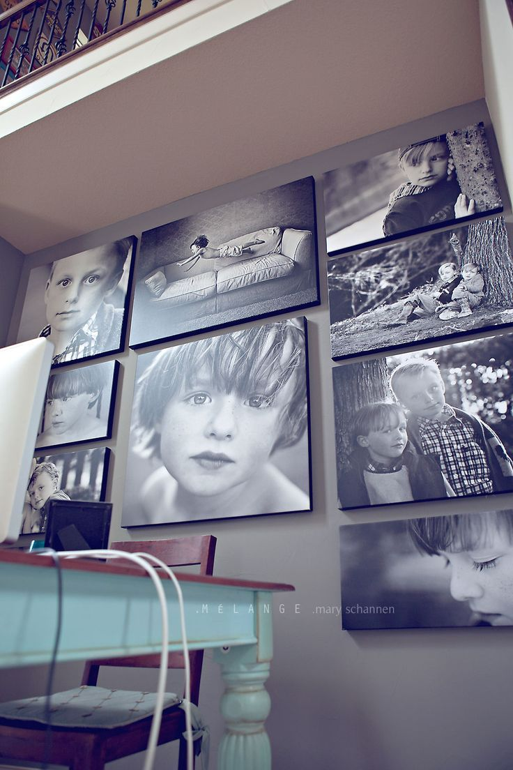 Stunning photo wall in office. just what I have wanted to do--perhaps with blueprint pics from Staples? You'd have to spend $$$$ to do this on canvasses