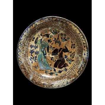 Safavid period earthenware plate (Kubachi ware) 1550s. Dancer with castenets.