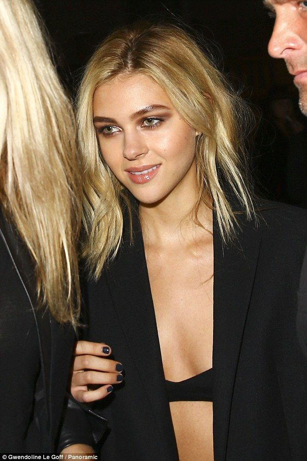 Good times: The Transformers star flashed a smile as she wore her blonde hair in a part...