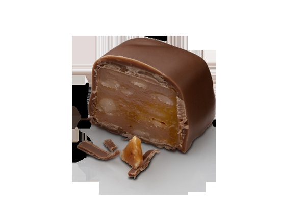 """With a milk toffee & walnut center and a milk chocolate shell, this """"turtle"""" will slowly but surely become a favorite. #lafetechocolat"""