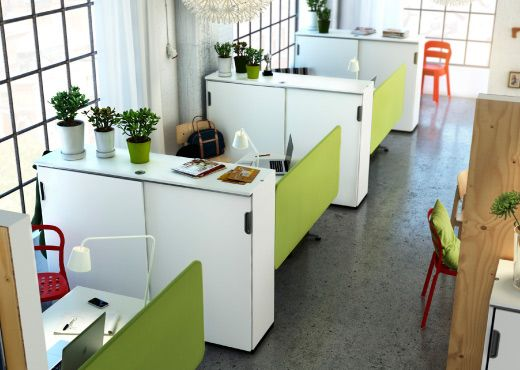 An office with GALANT white cabinets and desks and green desk screens - We love the pop of color on these desks.