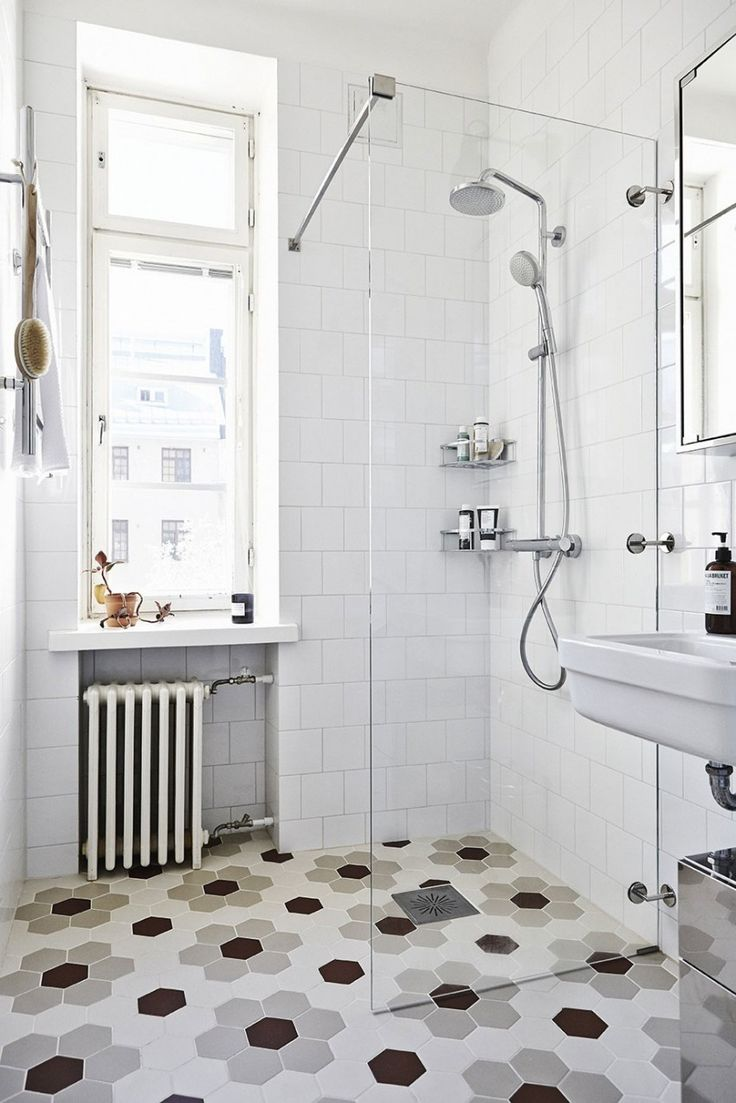 I like how simple the shower is. A drain in the floor, a glass panel and shower plumbing.