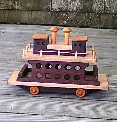 This wonderful wooden ship is a perfect toy for your little captain. Designed for ground-play, this beautifully handmade vessel comes with wheels to roll about on and car guards that come up and down for realistic ferry play. Not intended for use in water.