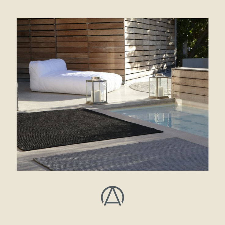 Beautifully hand-woven and crocheted rugs by Fibre Designs - tough enough for outdoors by the pool. Available from www.africandy.com.
