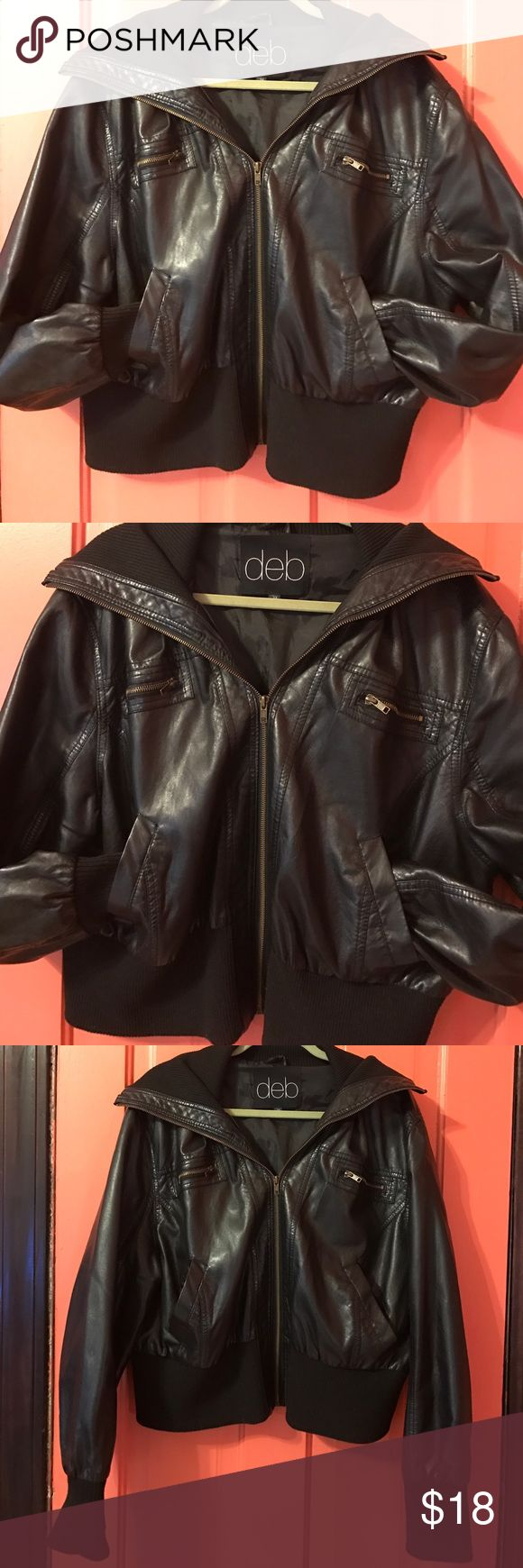 DEB Black faux leather jacket 3X DEB faux leather jacket. It is a short jacket, meant to sit about on your waist. Perfect for fall. Has pockets and zipper detailing. The sleeves have a wide black thick material. There is a black thick stretchy band along the bottom, do it is easy to stretch and zip around the waist. Size 3X. In great condition. Deb Jackets & Coats