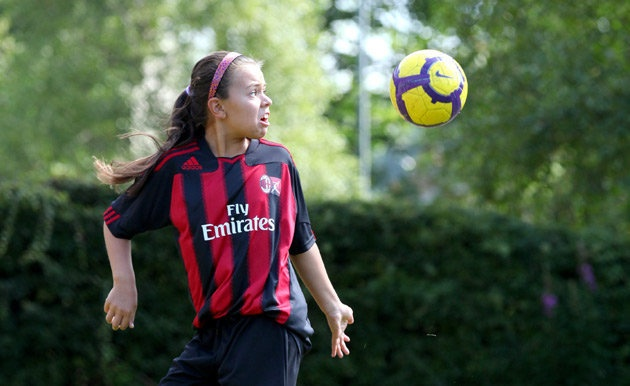 AC Milan headhunt 10-year-old British girl. A 10-year-old from Scotland is the first girl to have ever been invited to a prestigious European football tournament run by Italian giants AC Milan. http://www.acmilanextra.com/