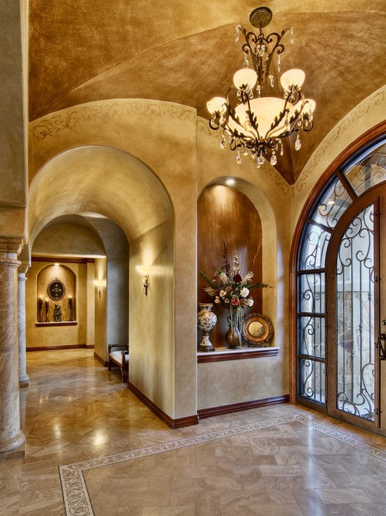 Beautiful tuscan entry way with huge art niche (love it), gorgeous lighting, rich warm tones on the ceiling, walls and floor that flow together so well. Also a beautiful door that allows lots of light. Just beautiful.