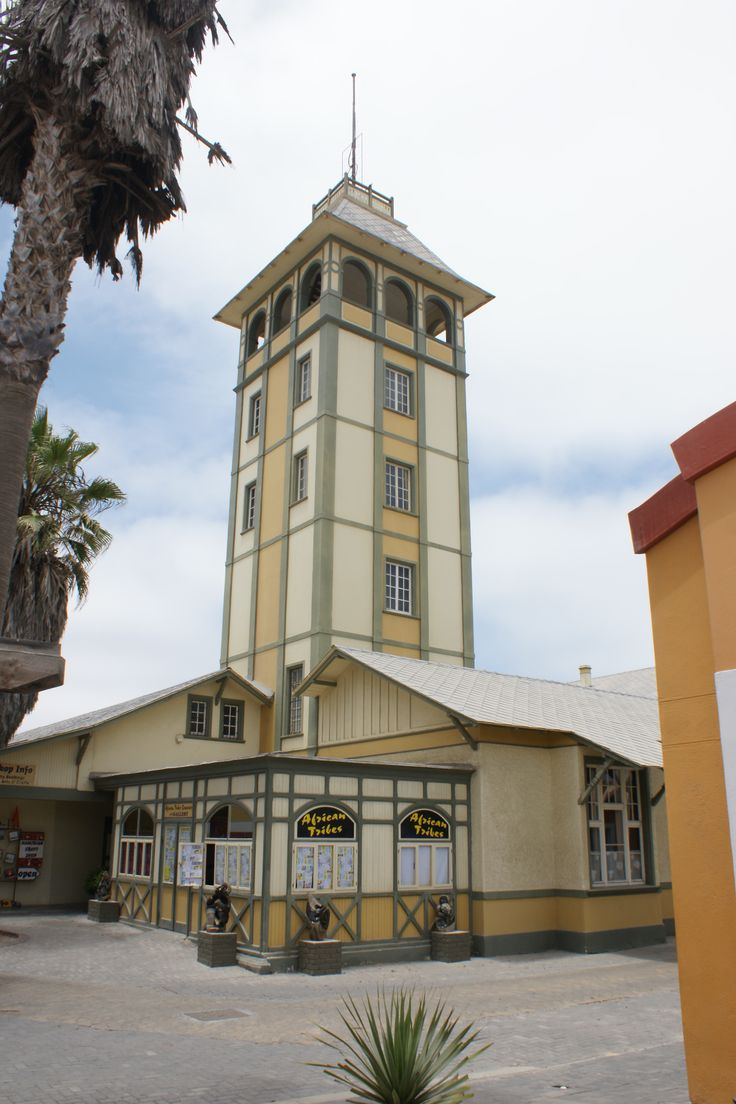 """Swakopmund (German for """"Mouth of the Swakop"""") is a city on the coast of northwestern Namibia, 280 km (170 mi) west of Windhoek, Namibia's capital."""