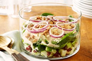 Jewelled Layered Salad recipe - Tossing the chopped apples with the lemon juice helps to prevent them from turning brown.   For more salad ideas, see www.kraftsaladcentre.ca