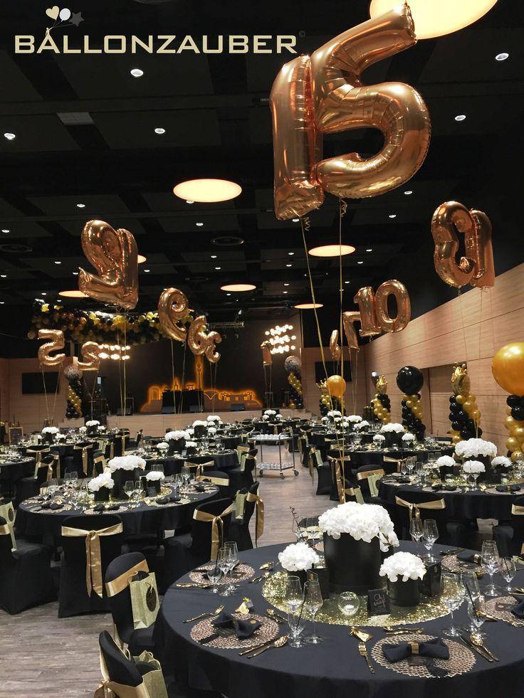 Different table numbers - in the form of golden balloons floating above each table. / Ballonzauber Dortmund- your partner for balloons, air ball ...