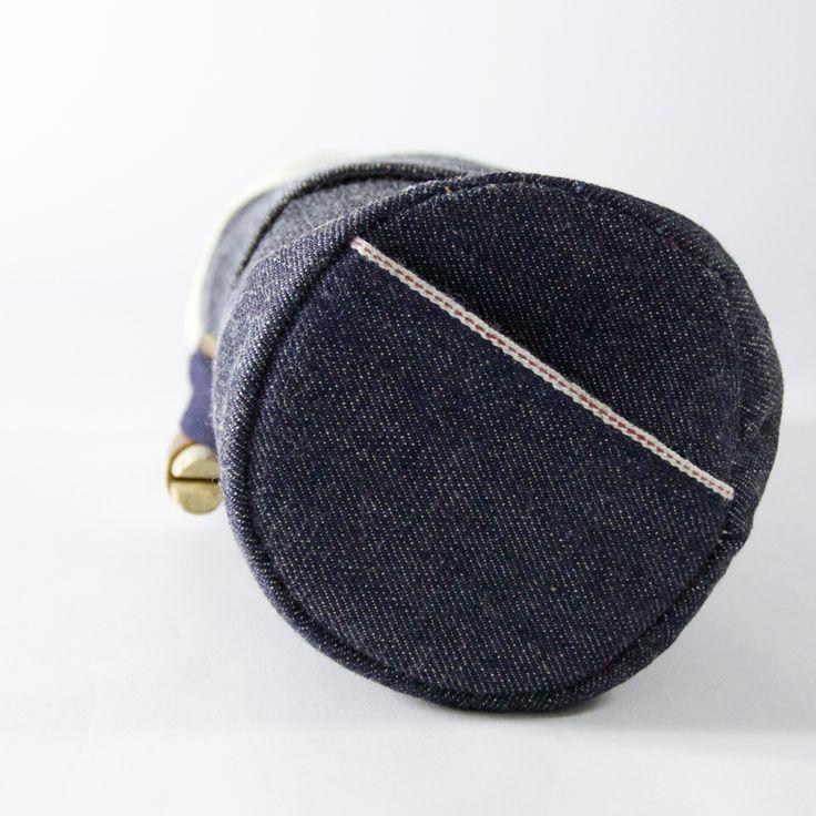 CULT OF ONE travel bag, side profile. cone mill selvedge denim, vintage wooden peg closer.