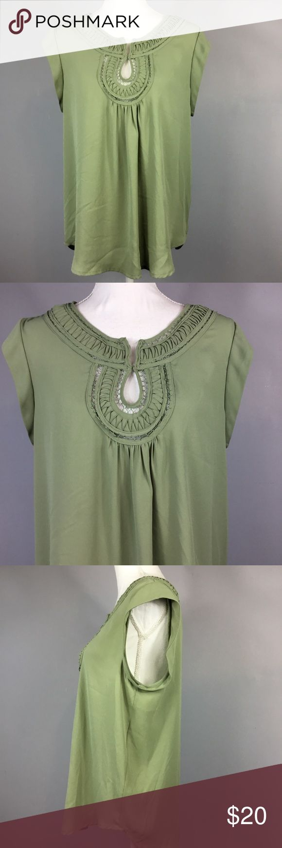 "Daniel Rainn Olive Green Short Sleeve Top Medium Daniel Rainn Olive Green Short Sleeve Blouse Womens Size Medium Casual   Measurements are laying flat 	•	Underarm to underarm 20"" 	•	Length 24"" from shoulder to hem Please check out my other items for more sizes and styles! Daniel Rainn Tops Blouses"