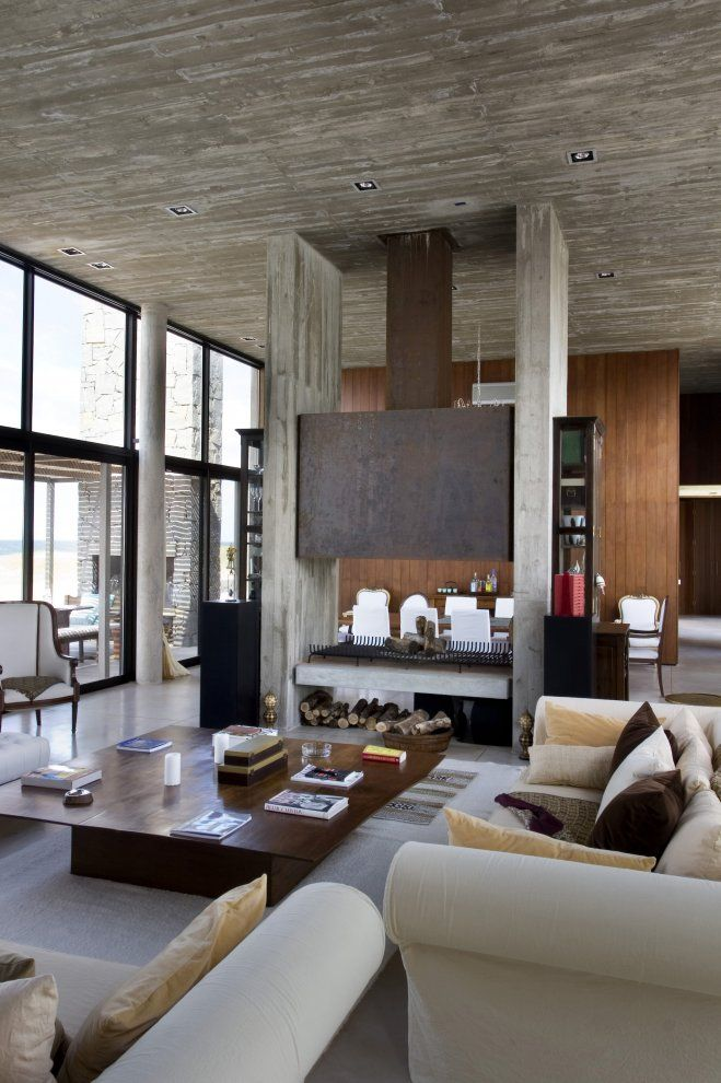 Like the cement/wood combination, love the fireplace dividing the two ambients.