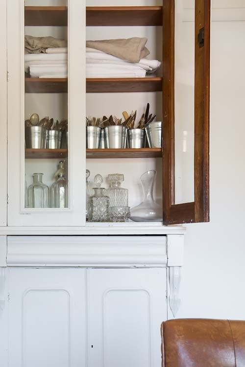 Cutlery stored in rustic buckets