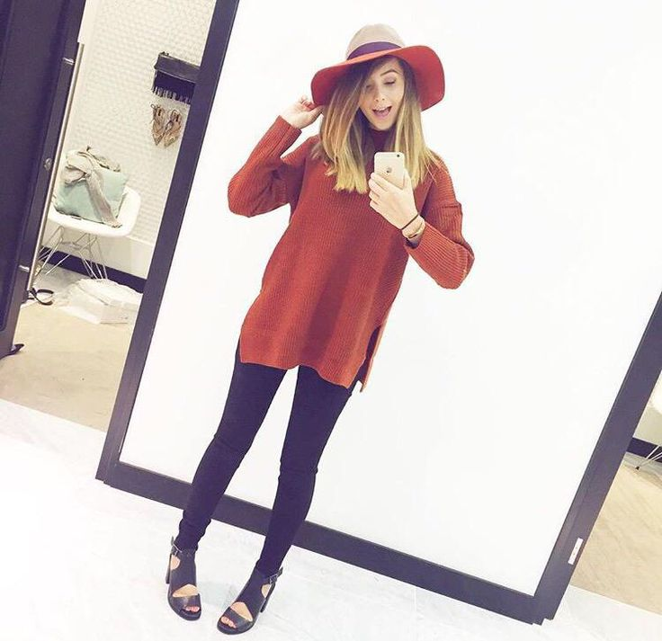 Zoella in a cute long Autumn jumper with a matching hat, black skinny jeans and black heels