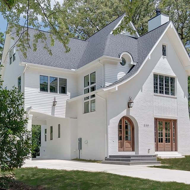 Built By Grandfather Homes This Home Exudes Curbappeal And Fresh Ideas Notice The Roof Lines And The House Exterior White Exterior Houses Exterior Brick