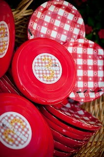 Frisbees serve double duty as plate holders for picnic food AND are the party favors!  By A. Party Style