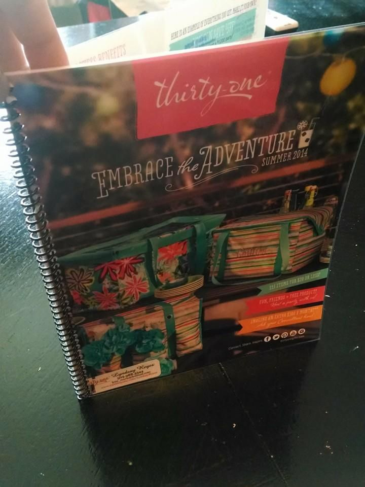 The most amazing SIX dollars at Staples!!! Have them laminate the front and back pages of the catalog. Then spiral bound the whole thing!! Now you have YOUR copy/display.