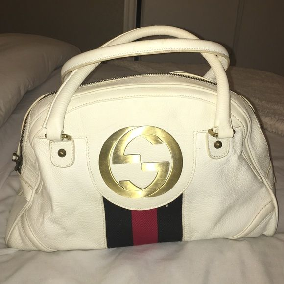 """Gucci Blondie Bowler Bag price is negotiable. Gucci white leather Blondie bowler handbag. With gold-tone hardware, dual rolled leather top handles (5"""" drop), a large signature interlocking """"GG"""" logo on front, navy blue and red Gucci canvas accent, and a top dual zipper closure w/ white leather zipper pulls. Interior of handbag is lined in white textile fabric with a single side zipper pocket. Don't know if real but has serial # 114914002586. Low price cuz authenticity cant be verified. No…"""