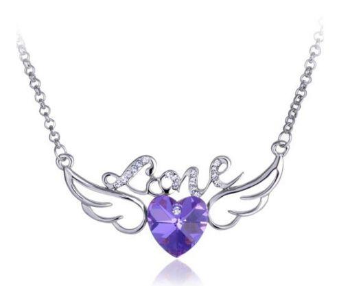 Superbe collier avec des ailes d'ange + 1 coeur au milieu