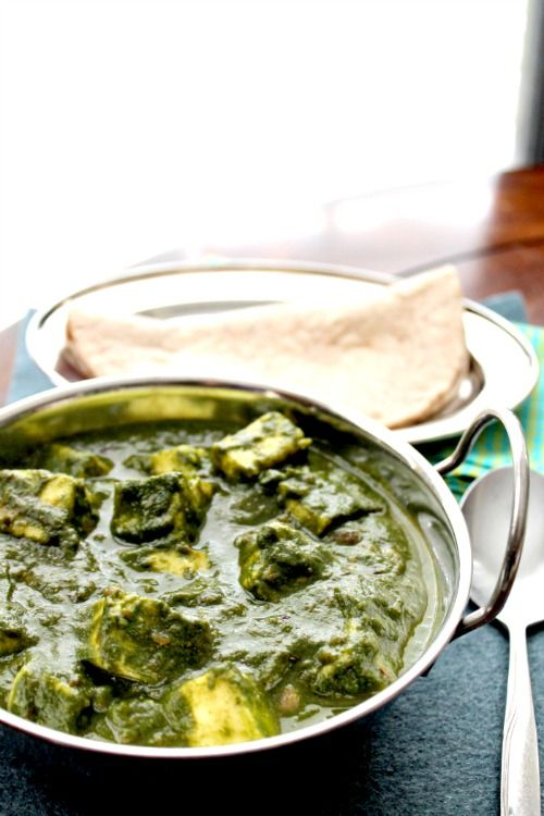 Fresh Spinach-2 Packets (6oz each) Paneer- 250 gms Cumin Seeds-1 tsp 2 medium Onions-chopped fine Crushed Ginger- 2 tsp Crushed Garlic-2 tsp Tomato - 2 Ground Coriander-2 tsp Ground Cumin- 1 tsp Garam Masala-1/2 tsp Red chili powder-1/2 tsp Sour creme or heavy cream-1 tbsp Oil-3 tbsp Salt- to taste   Click for instructions