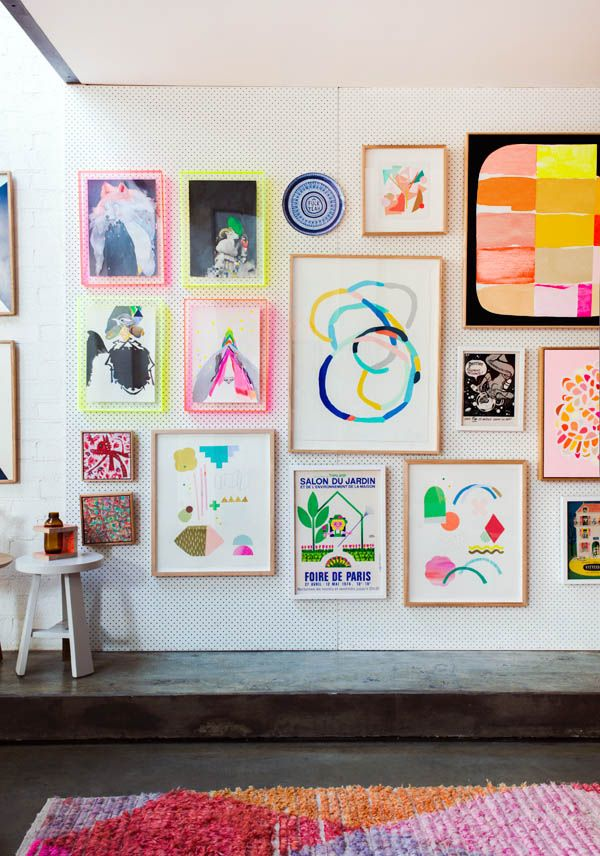 Love the colorful gallery wall plus the pegboard for creating this kind of evolving gallery wall is such a great idea