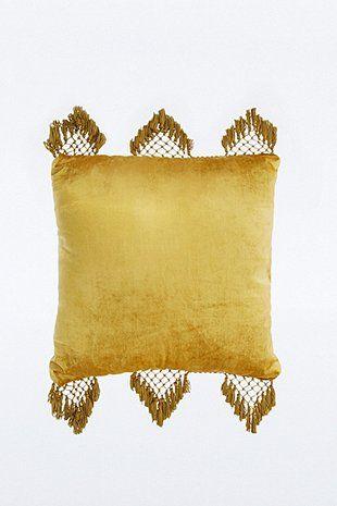 Coussin en velours jaune à franges