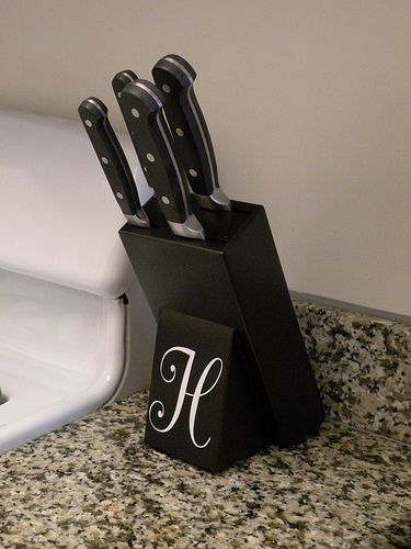 Update your kitchen knife block with some spray paint and a monogram!  Complete tutorial at www.houseofhepworths.com