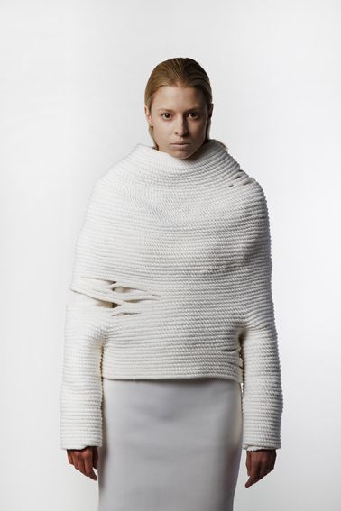 Makuba 2014 This almost simple garment is deceptive in terms of construction. The ease of the gaps at the side of the garment is actually quite tricky to form with knitted fabric. There is a strength to the garment and a sense of wrapping which also relates to my own work.  credit:katherinemavridis.com