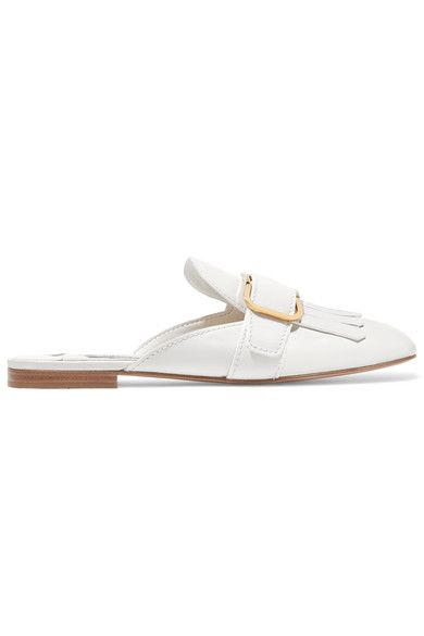 Prada's slippers are elegant and easy-going in equal measure. This pair has been meticulously hand-finished in Italy from smooth white leather and has a fringed toe topped with a polished gold buckle. Wear yours with skirts or jeans.