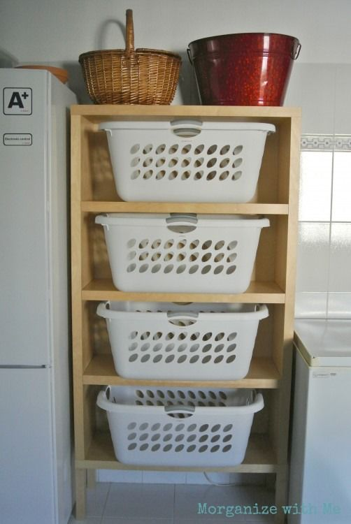 organized reader 39 s laundry room with a tower for laundry baskets