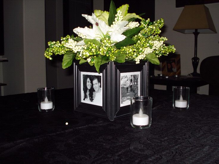 """$10 idea-- Paint Dollar Store frames, print out photos in black and white, Dollar Store vase inside frames (battery light in vase would be a nice touch also),  5 carefully chosen flower/greenery bunches from dollar store and """"Viola!"""""""