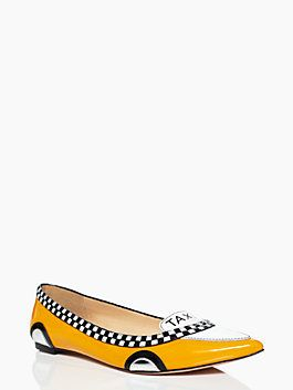 """we took a cue from our new york taxi cabs when designing this flat, crafted in bright yellow patent and trimmed in a black and white check print. finished with a """"taxi"""" printed tongue and an ever-so-slight stack heel, this cheerful shoe will actually inspire you to go it on foot."""
