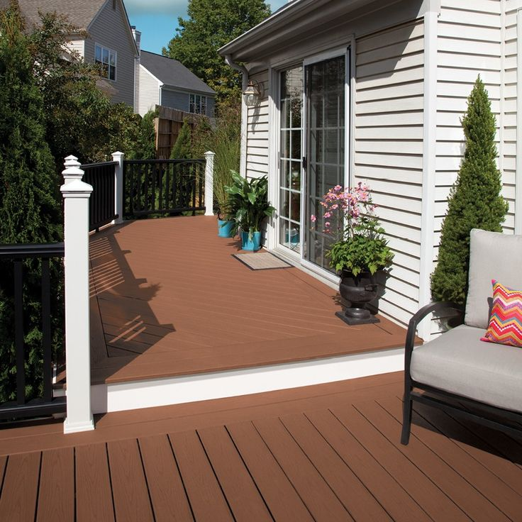 Enjoy the convenience and minimal upkeep of Trex composite decking right outside your backdoor.