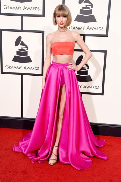 If Taylor Swift's crop top and maxi-skirt ensemble (obviously) from Versace looks familiar, just remind yourself of Emma Stone's Thakoon number from the 2014 Met Gala. (Or the prom dress from 10 Things I Hate About You.)  #refinery29 http://www.refinery29.com/2016/02/103279/grammys-2016-best-dressed-red-carpet-photos#slide-11
