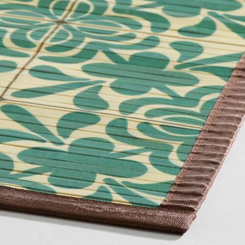 Sustainably handcrafted of raw bamboo with a fabric border, our exclusive natural fiber rug is printed with a blue and ivory geometric design. Our smooth bamboo rugs are easy to care for and great for high-traffic areas.