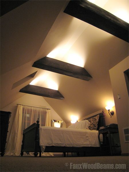 to faux beam or not to faux beam... that is the question???    Faux wood beams with lighting installed inside create a gorgeous look.
