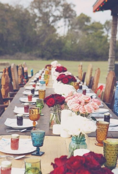 coloured glass, bright flowers, wooden chairs & tables