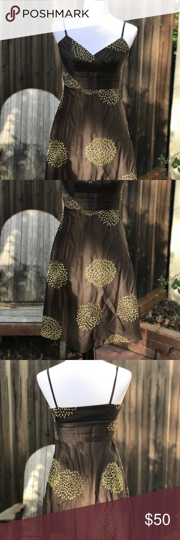 "Ann Taylor Brown/Gold Metallic Dress Ann Taylor Petites Dress. Spaghetti Strap, a-line, hidden side zip. Deep chocolate brown with gold metallic accent design. Shell 100% cotton, lining 100% Polyester. Dress has no stretch. Measurements approx. Bust 16"", waist 15"", hip 20"", length 38"". Mannequin 34x26x35. NWT Ann Taylor Factory Dresses"